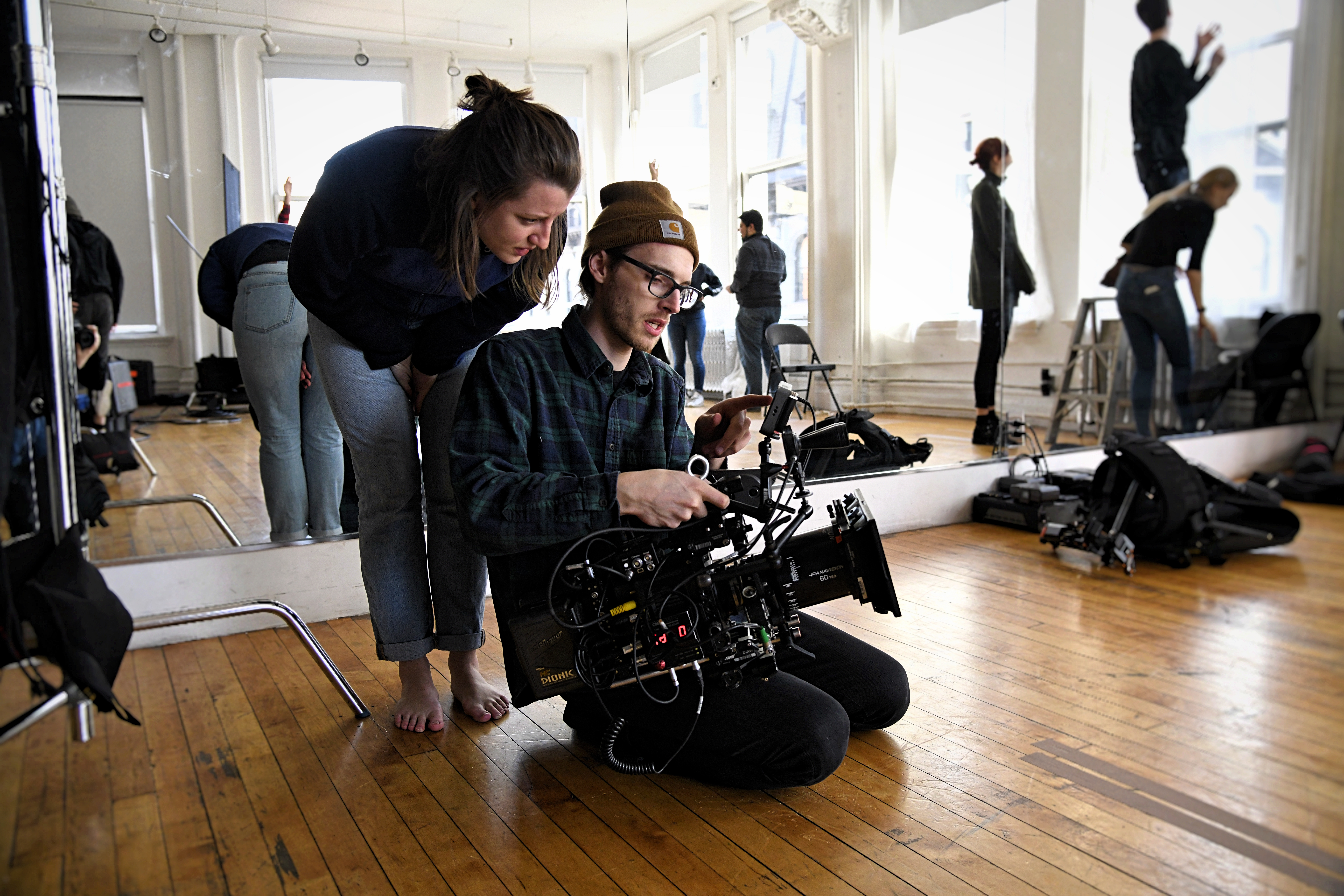 videographer inspecting equipment